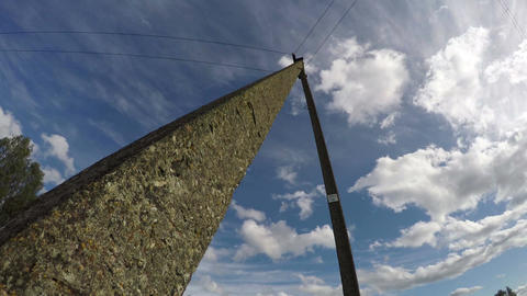 Electric pole against blue cloudy sky, time lapse 4k Footage