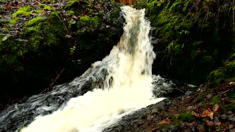 Slow motion. Cascade on small mountain stream, water is running trough big crack Live Action