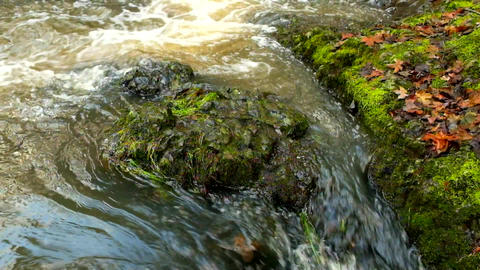 The colorful basalt stones in blurred water of mountain... Stock Video Footage