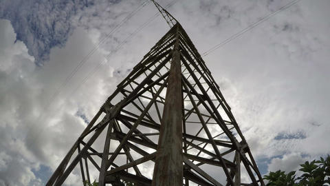 Electrical pylon against cloudy sky, time lapse 4k Footage