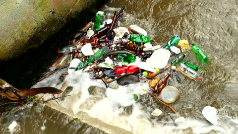 Plastic bottles and another mess turning on water level. Turning of dirty water  Footage