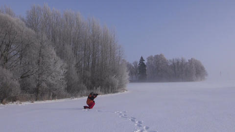 Photographer taking photos in winter Footage