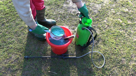 Agriculture sprayer sprinkler in garden and chemicals Live Action