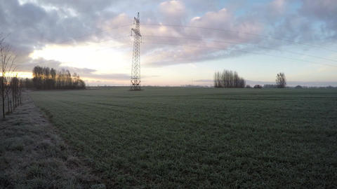 Spring sunrise on agriculture field and morning frost, time lapse 4K Footage