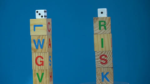 Rotating alphabetic cube with word Cash and Risk and game dice Footage