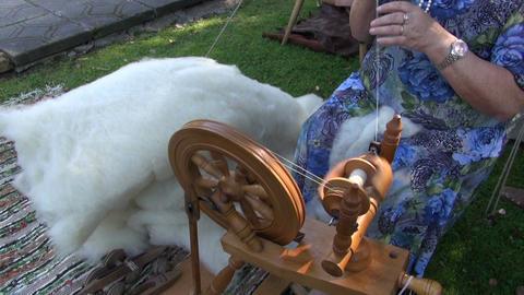 Woman spinning wool in medieval fair Footage