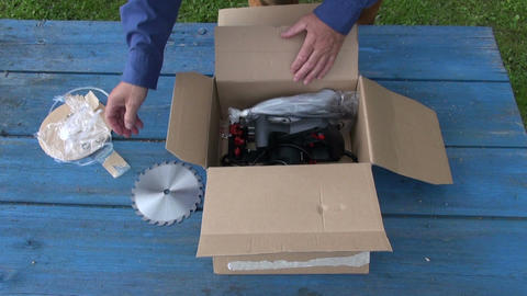 Carpenter unpacking circular saw Footage