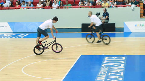 Young Sportsmen on Bicycles Ride and Show Jumps and Tricks Footage