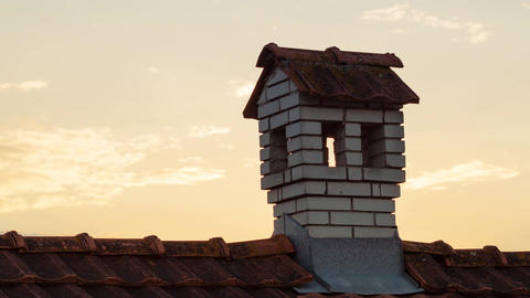 Chimney Like A Little House On The Roof in the evening twilight