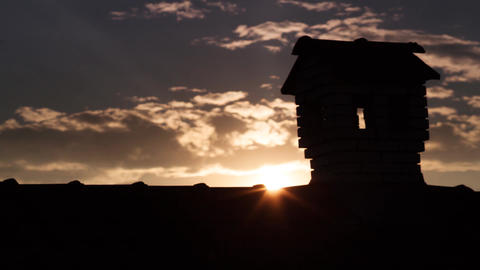 Silouhette of Chimney Like A Little House On The Roof in the evening twilight Footage