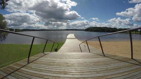 Footbridge to the lake, time lapse 4K Footage