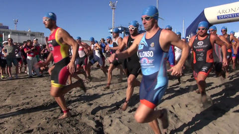 swimming competition start on Tenerife beach - running in water Footage