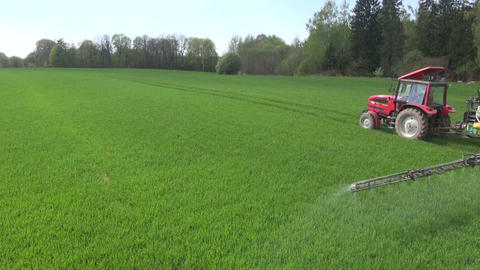 tractor spraying fields with pesticides on sunny day Footage