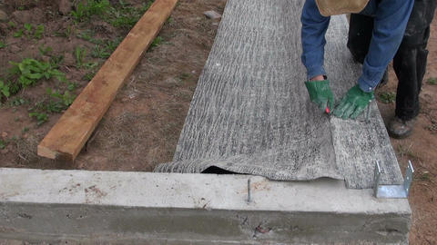 Cutting ruberoid for waterproofing foundation Footage