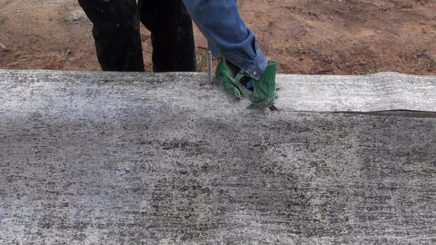 Cutting hole for an anchor in ruberoid for waterproofing foundation Footage