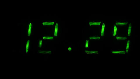Digital clock shows the time of 12 hours 29 minutes to 12 hours 30 minutes Footage