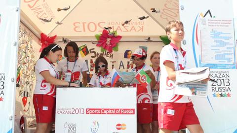 Children Stand Take Prospectus in Russian Sport Volunteer Tent Footage