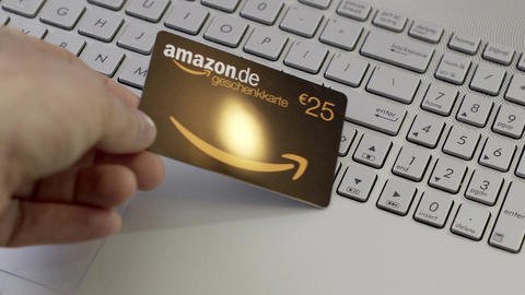 Anonymous Person Puts Amazon Germany Gift Card Onto Laptop