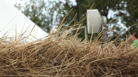 Camera Moves Past Dry Grass and Shows Man Tuning Antenna Footage