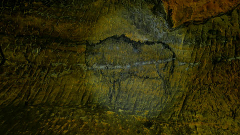 Buffalo hunting. Paint of human hunting on sandstone wall, prehistoric picture.  Live Action
