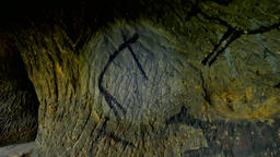 Discovery of prehistoric paint of caveman hunt in sandstone cave. Paint of human Live Action