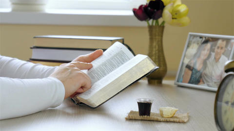Woman reading the Holy Bible before taking communion Footage
