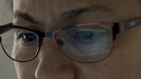 Twitter Logo Reflection in Glasses of Middle Aged Female Footage