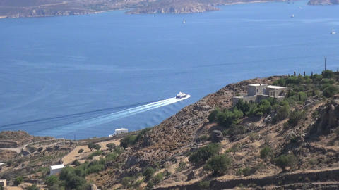 Luxurious Motor Yacht Leaving the Greek Island of Patmos