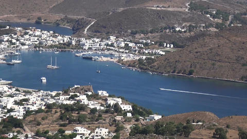Small Boat Entering the Port of Skala at Patmos Island in Greece Filmmaterial