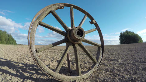 Antique wooden wheel in the field, time lapse 4K Footage