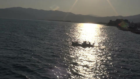 Small Fishing Boat against the Sun Footage