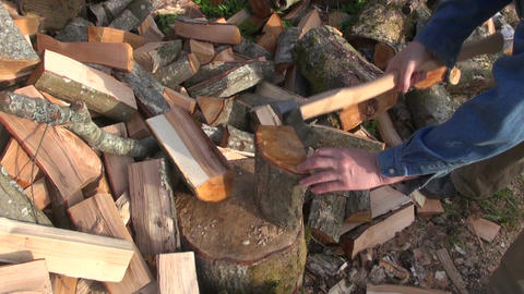 Farmer chopping wood Footage