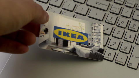 Anonymous Person Puts IKEA Gift Card Onto Laptop Footage
