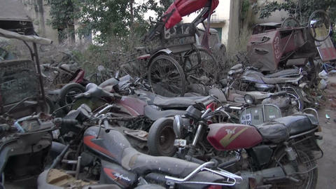 Jaipur, Rajasthan, India, December 2012 - metal scrap yard full of vehicles Footage