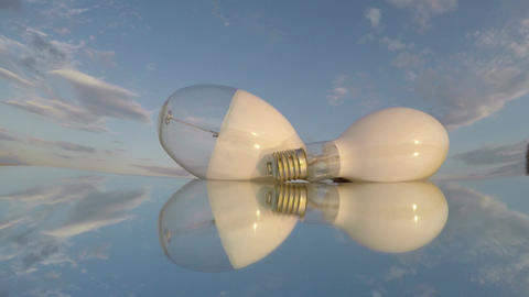 Two white transparent light bulbs on mirror, time lapse 4K Footage