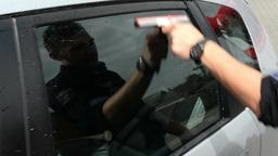 Man washing car window with window cleaner Footage