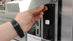 man insert a coin into the machine Footage