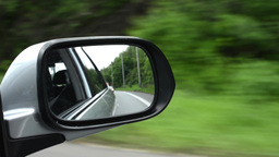 ride in the car - reflection in the rearview mirror Footage