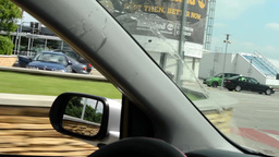 A man drives a car - enter into the car park Footage