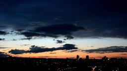 time lapse sunset - city Prague, Czech Republic. Night clouds Footage