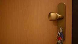 keys in the lock(door) - key to swing Footage