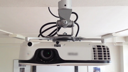 electronic projector - hanging on the wall Stock Video Footage