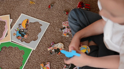 child(small boy) plays with toys in the room - toys(puzzle or jigsaw) Footage
