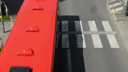 Cars drive on the road via the pedestrian crossing Footage