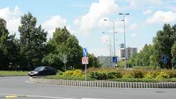 roundabout in the city with cars and nature in the background Footage