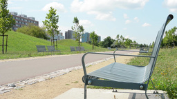 benches in the park with housing estate (development) Footage