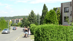 street with houses and people - green nature (summer) Footage