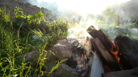 Slow motion campfire burning in tourist camp at sunset. Carpathian mountains Footage