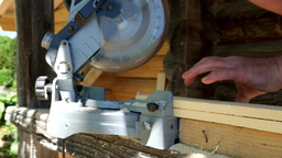 Slow motion carpenter cutting wooden plank with circular blade saw Footage