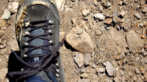 Hiking across cracked desert landscape. Slow motion. Global warming concept Footage